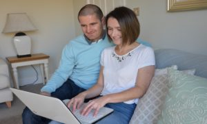 Young couple researching how to buy more shares in their home